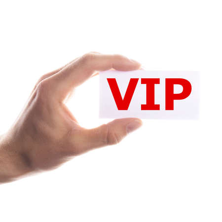 vip or very important person concept with hand and paper Stock Photo - 7322177