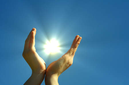 hand sun and blue sky showing hope peace or freedom concept Stock Photo - 7322250