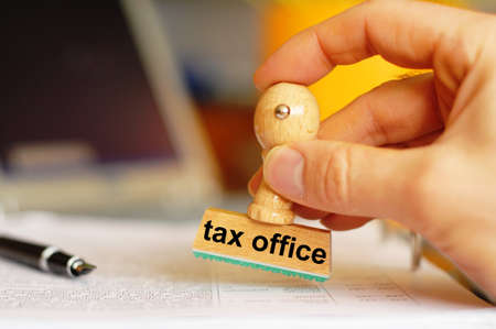 tax office concept with stamp and copyspace  photo