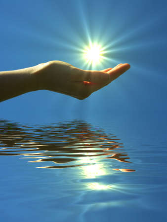 hand holding sun and water reflaction with copyspace