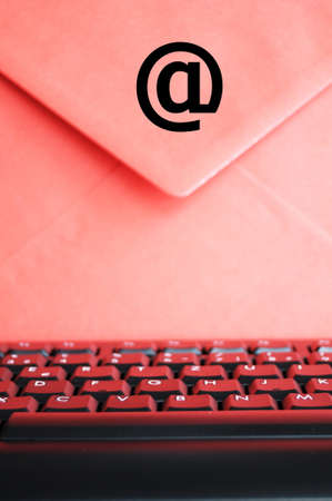 envelop: email concept with envelop and keyboard showing modern communication Stock Photo