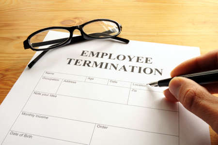 termination: employee termination form on desk in business office showing job concept Stock Photo