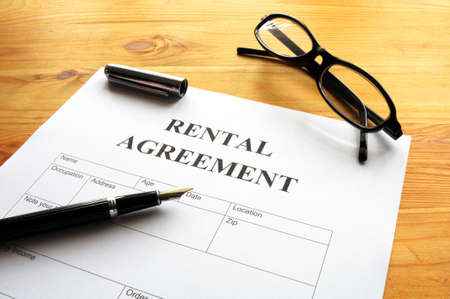 agency agreement: rental agreement form on desktop in business office showing real estate concept