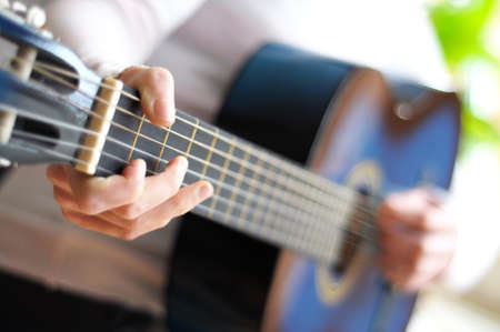 blue music guitar with blurry copyspace for your text message photo