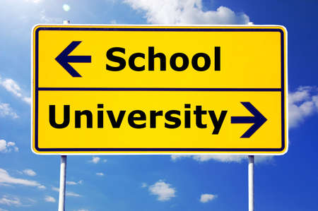 school and university education concept with yellow road sign                                     photo