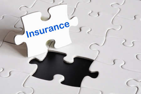 insurance concept with white puzzle or jigsaw  photo