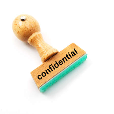 confide: confidential concept with stamp in office and copyspace