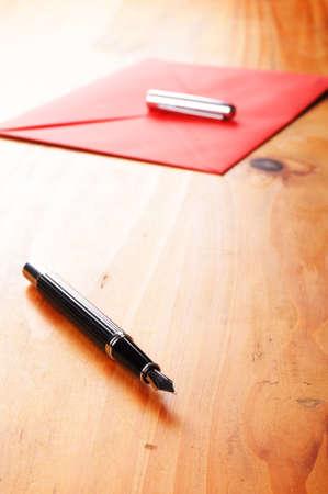 envelop: envelop and pen showing mail or communication concept