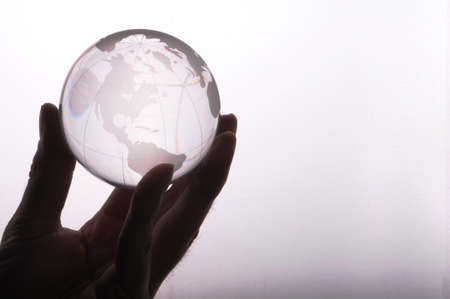 globe in hand isolated on white showing eco environment or business concept photo