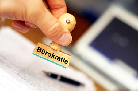 burocracia: bureaucracy concept with stamp in office and copyspace Banco de Imagens