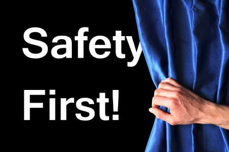 safety first concept showing risk behind blue curtain photo