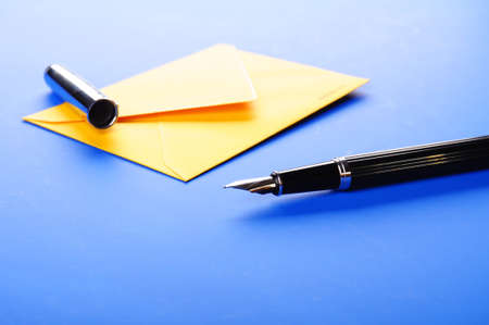 envelop and pen showing mail or communication concept photo