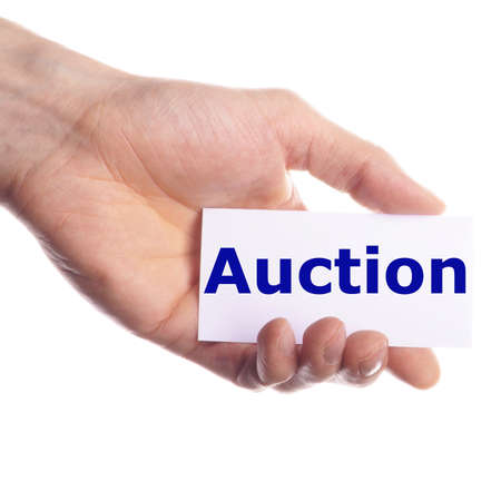 buy or sell on auction concept with hand holding paper  photo