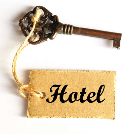reception room: travel concept with hotel key and tag or label Stock Photo