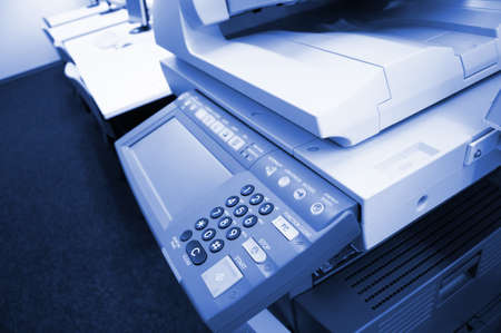 copier center or desktop in office showing paperwork concept photo