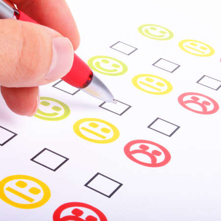 positiv: hand pen and checkbox or tickbox with smilie