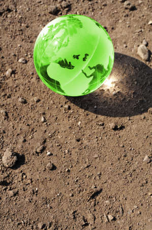 climate change concept with earth planet on dry soil and copyspace Stock Photo - 7403645