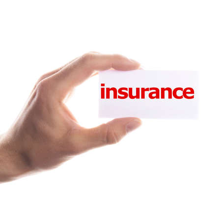 health insurance: insurance concept with hand word an paper