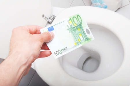 waste of money concept with euro bill and toilet photo