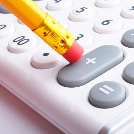calculator showing business accounting concept in white photo