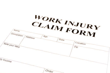 work safe: work injury claim form showing business insurance concept
