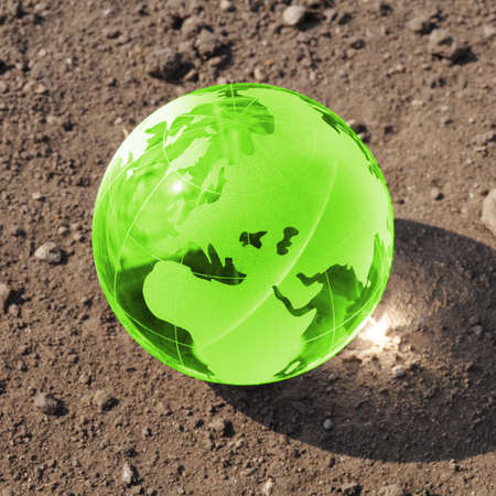climate change concept with earth planet on dry soil and copyspace photo