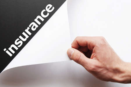 insurance concept with hand word an paper Stock Photo - 7485724
