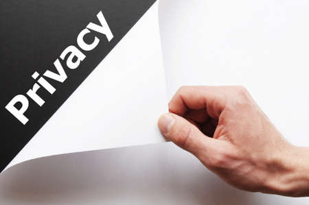 privat: privacy concept with hand word and paper