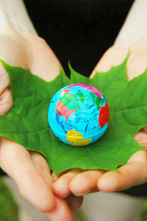 globe and leaf in hands for environmental conservation Stock Photo - 7485758
