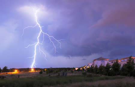 thunderstorm with lightnings and cloudy sky at rainy\ night