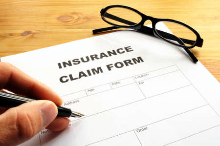 policy document: insurance claim for on desk in office showing risk concept Stock Photo