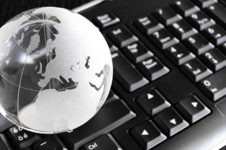 globe and keyboard showing global communication or internet concept photo