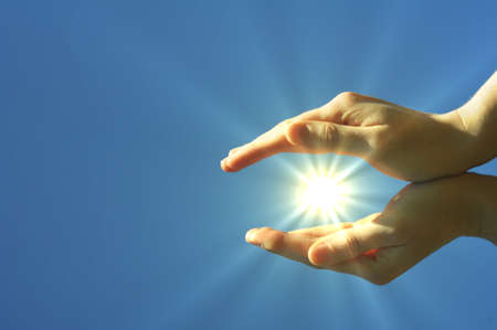 hand sun and blue sky with copyspace showing freedom or solar power concept Stock Photo - 7522276
