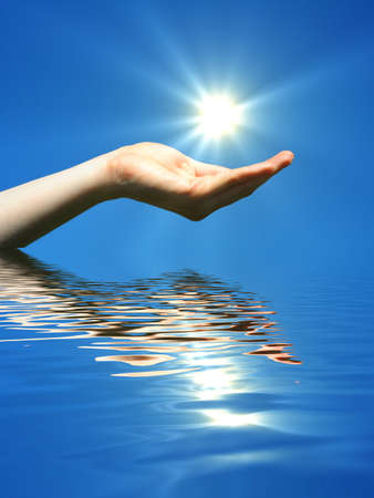 hand holding sun and water reflaction with copyspace Stock Photo - 7522370