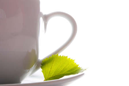 cup of tea or coffee with leaf and white copyspace