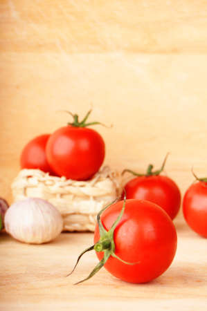 tomatoes vegetable and garlic with copyspace showing food concept photo