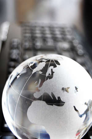globe and keyboard showing global communication or internet concept Stock Photo - 7534365