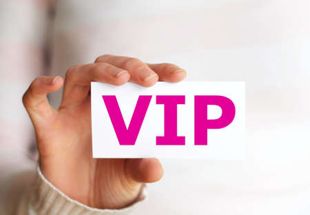 vip or very important person concept with hand and paper photo