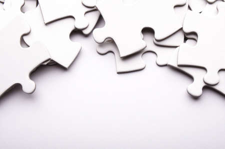 whote: puzzle or jigsaw on whote blank paper with copyspace Stock Photo