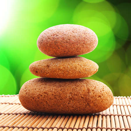 zen stones with green leaves and copyspace showing wellness Stock Photo - 7568548