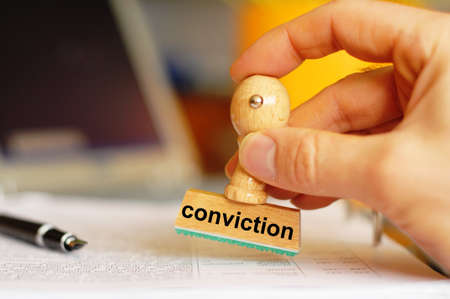 conviction: conviction on stamp in office showing law or crime concept with copyspace Stock Photo