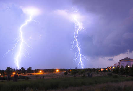 thunderbolt: lightning on a thunderstorm in a park with cloudy sky
