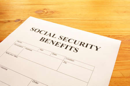 layoff: social security benefits form showing financial concept in office Stock Photo