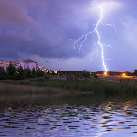 thunderstorm with lightnings and cloudy sky at rainy night Stock Photo - 7634612
