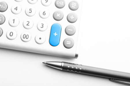 financial accounting concept with white calculator in office Stock Photo - 7663972
