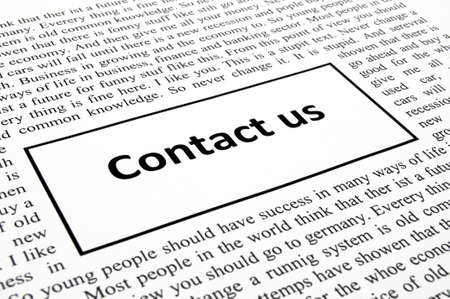 contact us concept with newspaper showing business communication photo