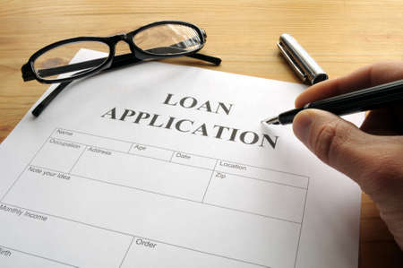 business loans: loan application form or document in bank office showing finance concept Stock Photo