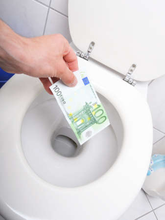 slump: money and toilet showing financial crisis concept Stock Photo