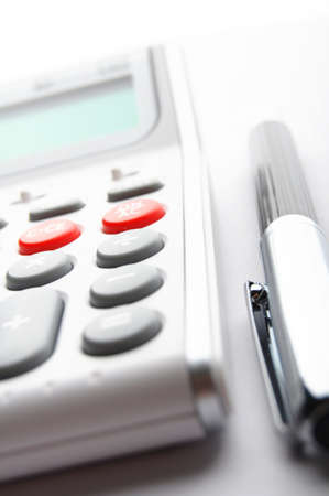 business calculation concept with modern white calculator photo