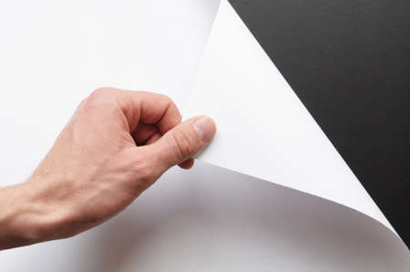 page or blank sheet of paper with hand and copyspace in the corner photo